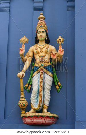 Statue of god Vishnu on Hindu temple wall poster