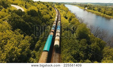 Freight Train With Cisterns And Containers On The Railway. Aerial View Container Freight Train, Loco