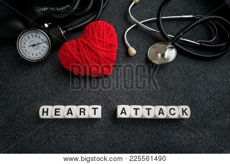 Word Heart Attack From White Cubes With Letters On Dark Background With Red Thread Heart And Tonomet