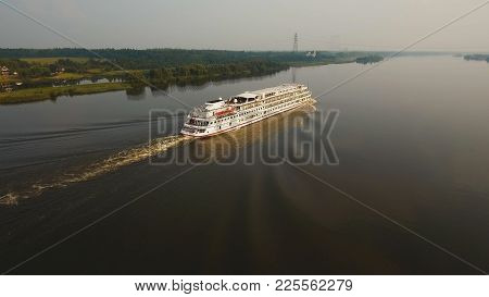 Aerial View.large White Cruise Ship On A River.cruise Ship Sailing Along The River Among The Green F