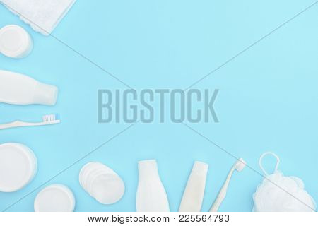 Minimalistic Background With Lotion In Bottles, Cream In Containers, Toothbrushes, Sponge And Cotton