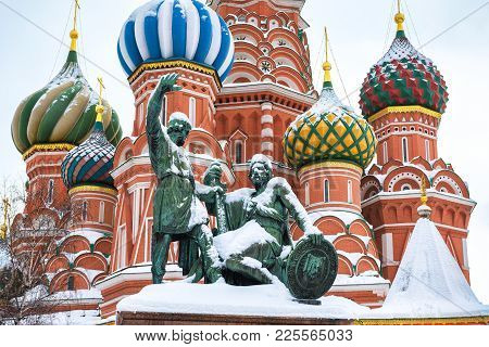 St. Basil`s Cathedral And Monument To Minin And Pozharsky On The Red Square During Snowfall In Winte