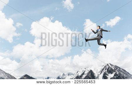 Businessman in suit running in the air as symbol of active life position. Skyscape and nature view on background. 3D rendering. poster