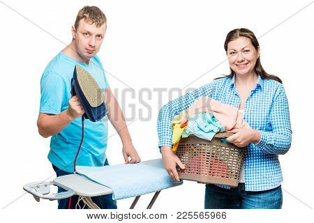 Woman With Laundry Basket And Man With Iron On White Background While Ironing Clothes