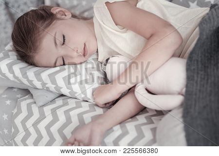 Sweet Dreams. Cute Lovely Long-haired Girl Sleeping In Her Bed And Hugging Her Favourite Toy And Wea