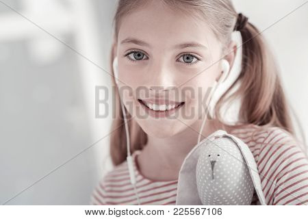 Being A Teenager. Attractive Exuberant Grey-eyed Lovely Girl With Pig-tails Smiling And Holding A To
