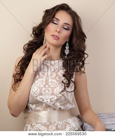 Beautiful Woman In Lace Dress With Hairstyle And Make-up