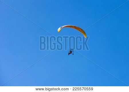 Yellow Moto-paraglider Flying Over Clear Blue Sky