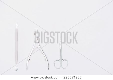 Top View Of Nail Nippers And Scissors Isolated On White