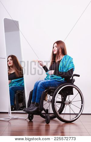 Disability Beauty Invalid Happiness Concept. Disabled Girl Looking At Mirror. Crippled Lady Sitting