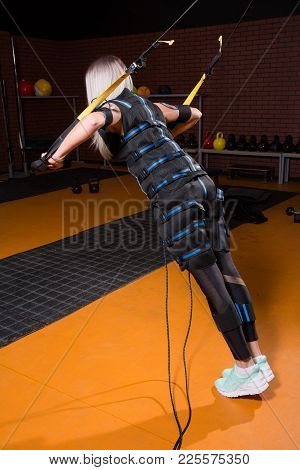 Woman With Back In Electrical Muscular Stimulation