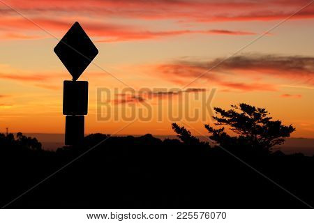 Road Sign Silhouette And Colorful Sunset From Twin Peaks, San Francisco.