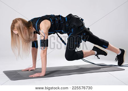 Beautiful Blonde In An Electric Muscular Suit For Stimulation