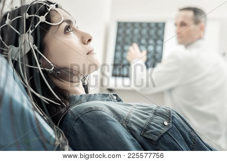Electro Scanning. Nice Beautiful Young Woman Lying On The Bed And Wearing Wires While Undergoing Ele