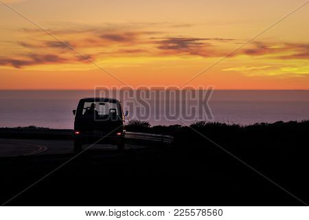 A Van Facing The Pacific Ocean During The Sunset