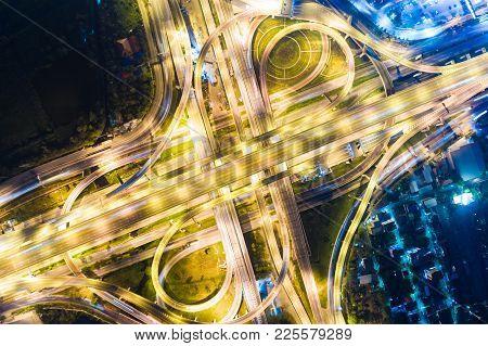 Traffic Across Junction Road At Night