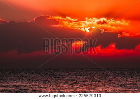 Red Sky Tropical Sunset. Beautiful Fantasy Cloudscape With Blood Orange Light From Sun Behind Cloud.