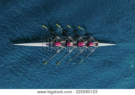 Women's Rowing Team On Blue Water
