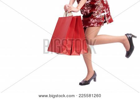 Close Up Of Young Asian Beauty Woman Legs Wearing Cheongsam And Holding Shopping Bag Gesture In Chin