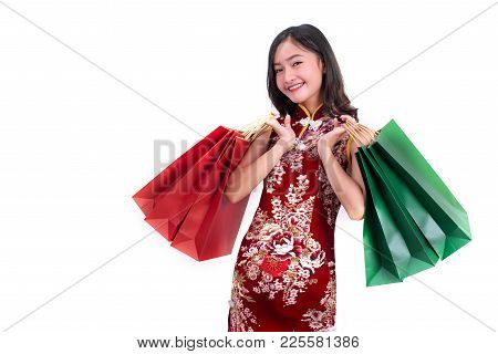 Young Asian Beauty Woman Wearing Cheongsam And Holding Red And Green Shopping Bags Gesture In Chines