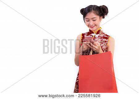 Young Asian Beauty Woman Wearing Cheongsam And Using Smart Phone Gesture In Chinese New Year Festiva