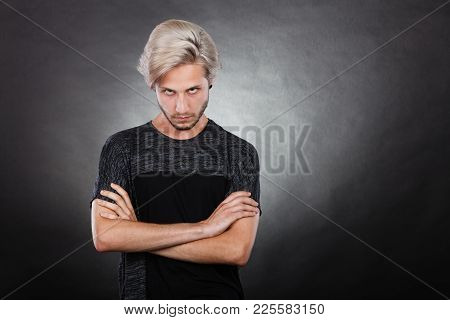 Negative Emotion, Feelings Attitude. Angry Grumpy Young Man Looking Very Displeased Standing With Ar
