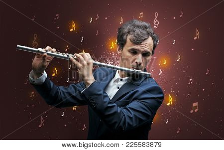 Young flutist with falling musical notes wallpaper and classical concept