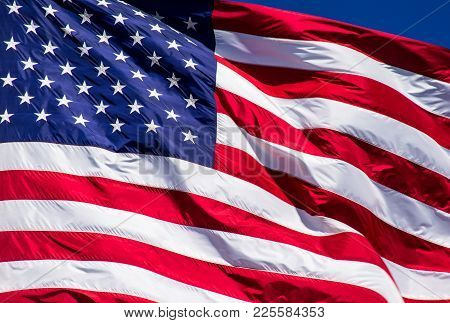 Perfect American Flag Waving In The Wind With Perfect Ripples Along The Stars And Stripes Of The Sym