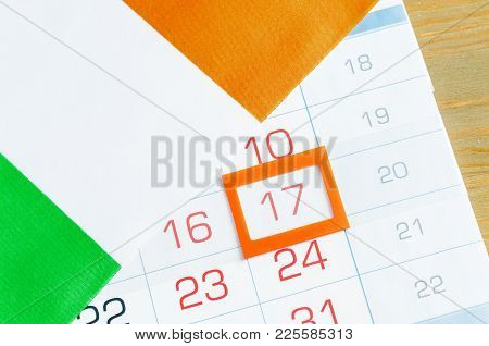 St Patrick's Day Festive Background. Irish Flag Covering The Calendar With Framed 17 March