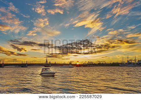 Beautiful Sunset On Neva River With Troitsky Bridge And Peter And Paul Fortress On The Background. S