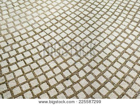 Rows of stone paving in pedestrian walk way