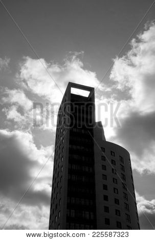 Silhouette of modern comercial building against cloudy sky