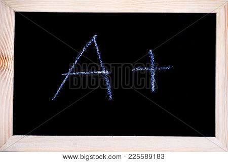 Blackboard With White Chalk Writing Showing Grade A+