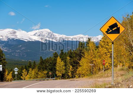 Steep grade truck road sign on highway at autumn sunny day in Colorado, USA.