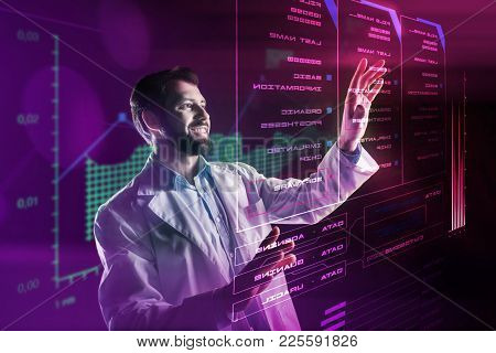 Positive Programmer. Cheerful Enthusiastic Experienced Programmer Standing In Front Of A Modern Amaz