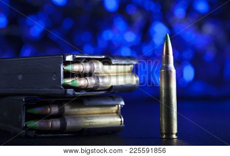 Blue Background With Ar-15 Ammo And Steel Magazines Up Front