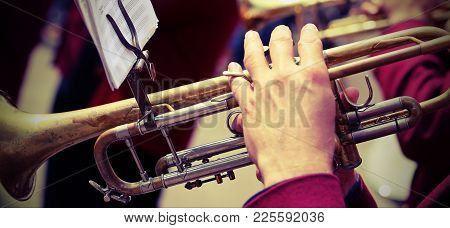 Trumpeter Plays His Trumpet In The Brass Band During Live Concert With Vintage Effect