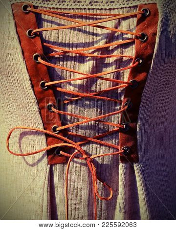 Intertwining With The String Of An Ancient Medieval Dress With Vintage Effect