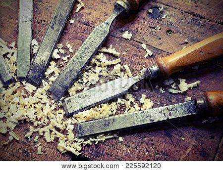 Sharp Steel Blades Many Chisels And Sawdust Chippings In Workbench With Vintage Effect