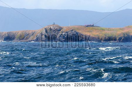 Monument At Cape Horn. With Stormy Sea. Tierra Del Fuego Province, Chile. South America