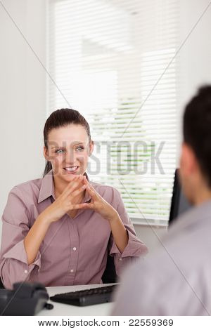 A businesswoman is discussing with a man