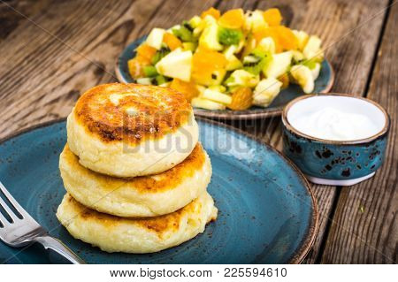 Hot Delicious Curd Pancakes With Fruit Salad And Yogurt. Studio Photo
