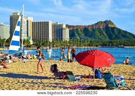 January 28, 2018 At Waikiki Beach In Honolulu, Hi:  Popular Sandy Beach With People Sunbathing, Swim