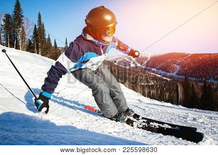 Action Camera Skier In Mountains, Prepared Piste And Sunny Day