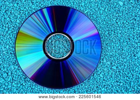 Round Compact Disc On Small Green Stones