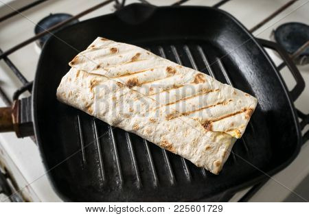 Roll Of Pita Bread In A Frying Pan. Grilled Rolls Of Bread Lavash With Roasted Chicken And Fresh Veg