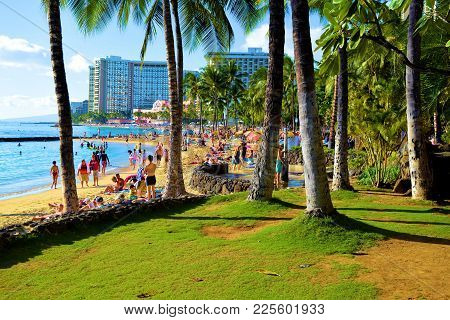 January 28, 2018 At Waikiki Beach In Honolulu, Hi:  Park With Manicured Landscaping Including Tropic