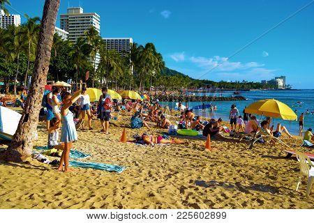 January 28, 2018 At Waikiki Beach In Honolulu, Hi:  People Sunbathing On A Popular Crowded Sandy Bea