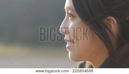 Side profile of woman look at the sunset