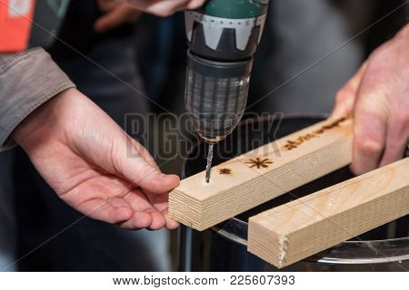 Carpenter Drills A Hole With A Cordless Screwdriver - Close-up